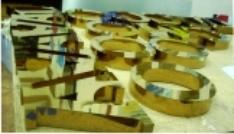 Объемные буквы из полированной нержавеющей стали с напылением «под золото»